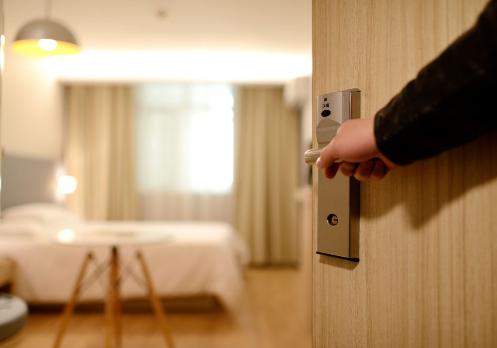 Opening hotel door with locking systems installed