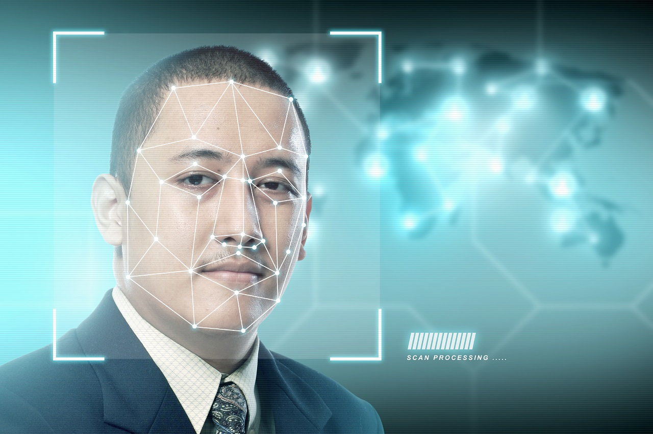 An asian businessman whose face is being scanned by facial recognition