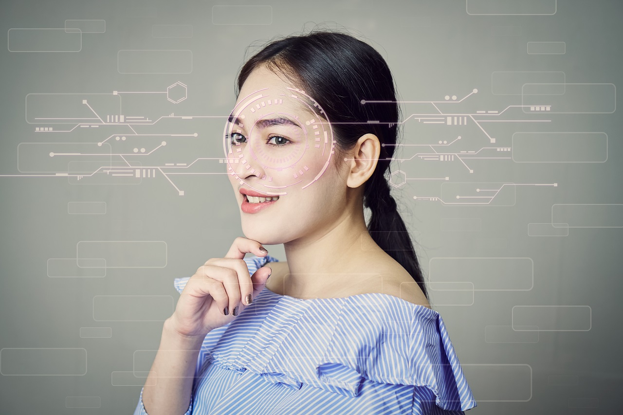 A girl whose face is being scanned by facial recognition