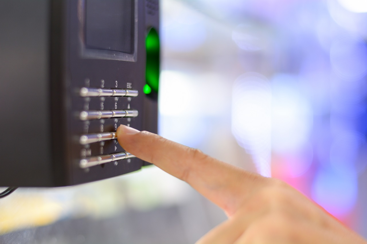 Close up of a finger clocking into a biometrics system