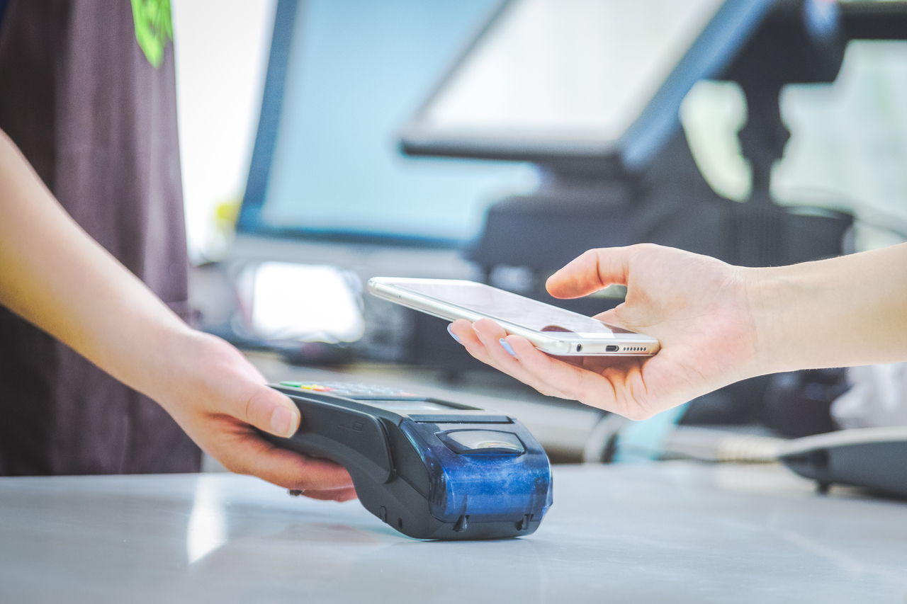 Close up of a hand transacting using a cashless payment system