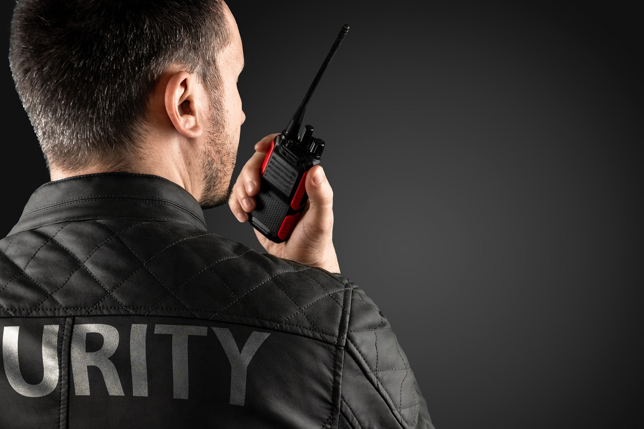 Security personnel talking on a walkie talkie
