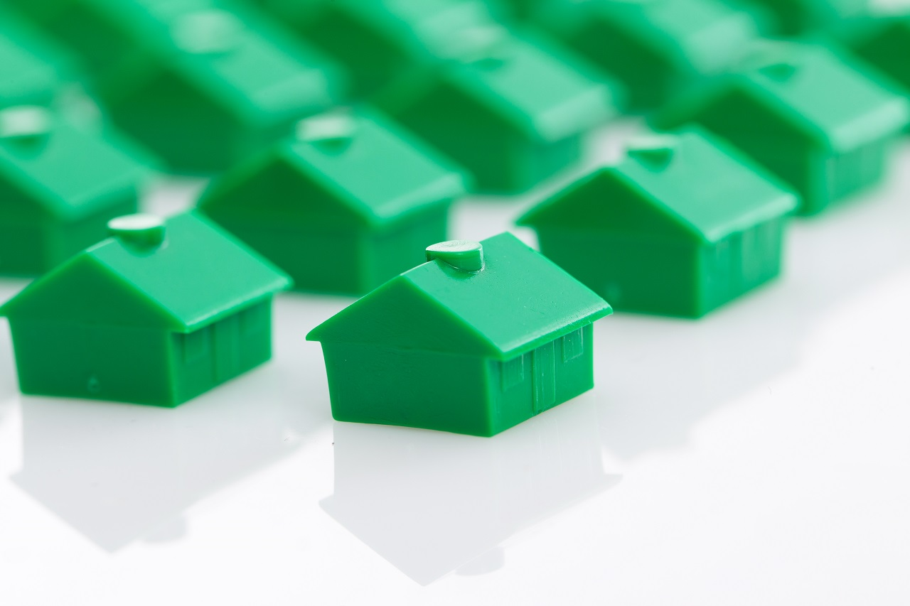 Miniature green toy houses