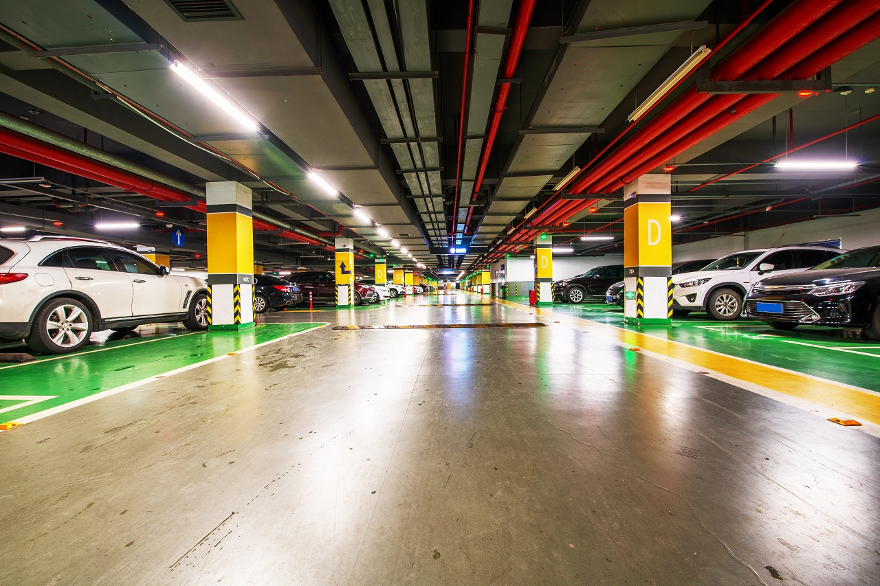 An underground parking lot with parking systems