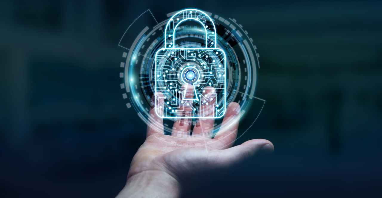 A hand with graphics of cybersecurity
