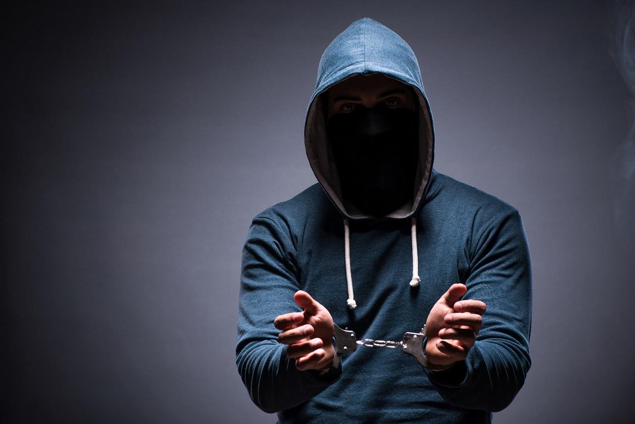 A criminal caught in handcuffs