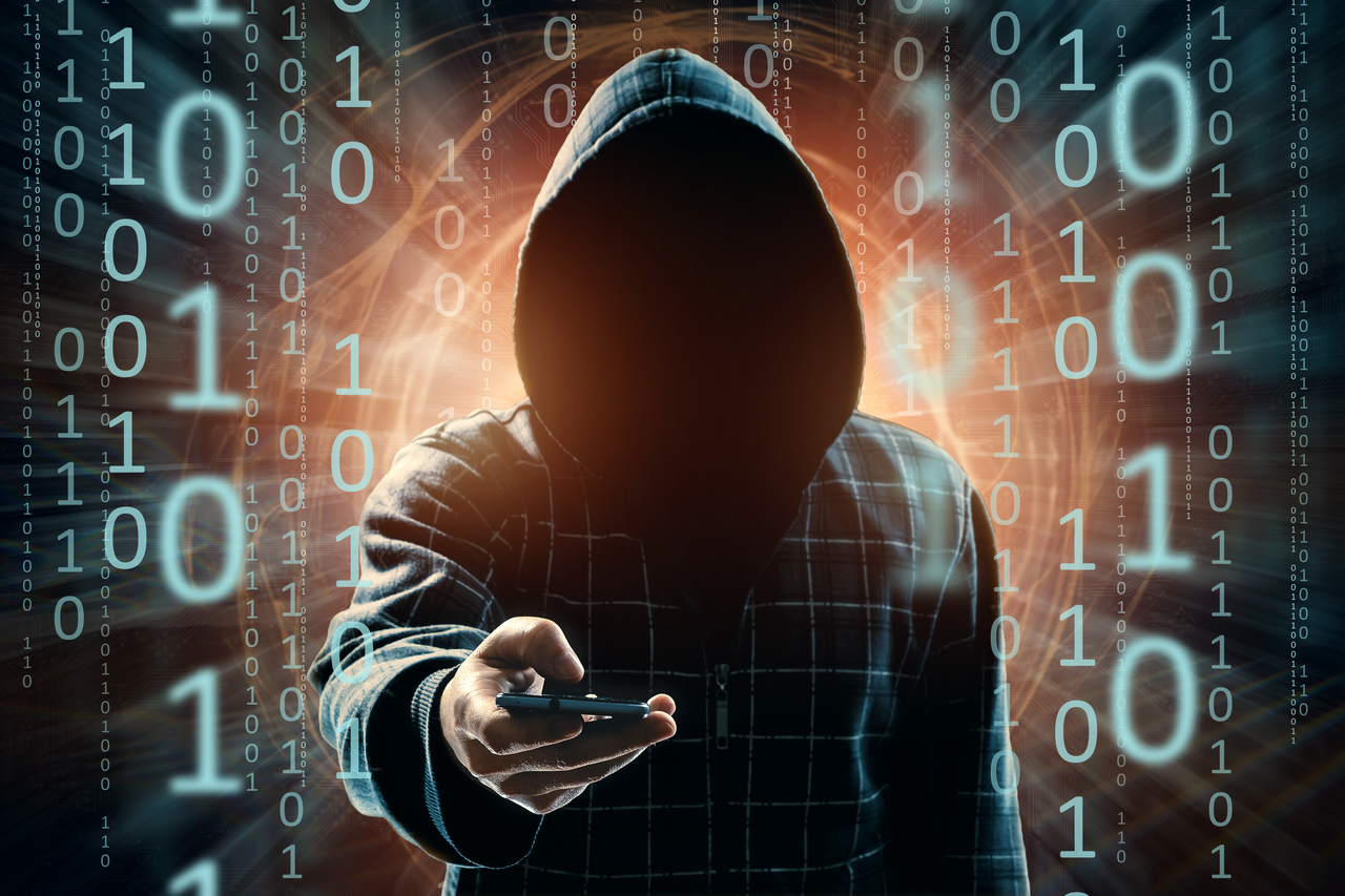 A hooded man committing Distributed Denial of Service Attacks