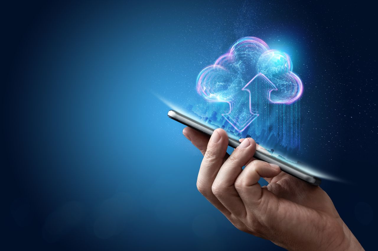 Graphics of a person accessing cloud data through a cellphone