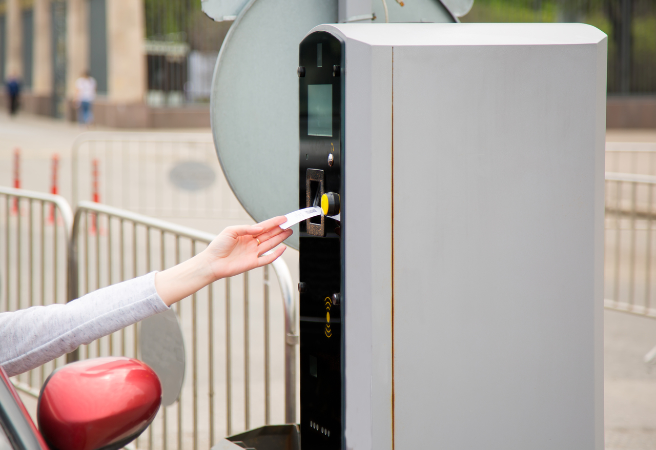 A person paying with a smart parking system