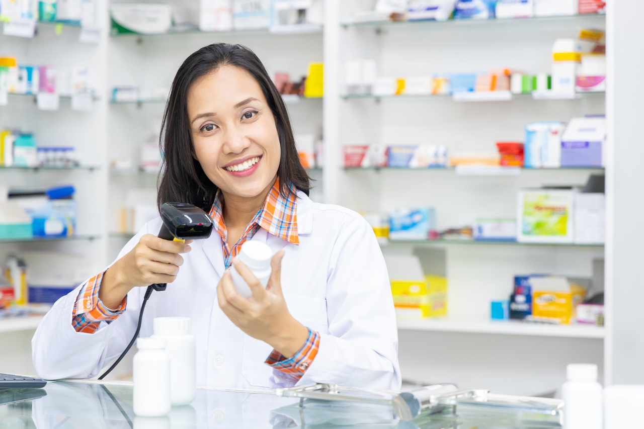 A pharmacist scanning a product with RFID