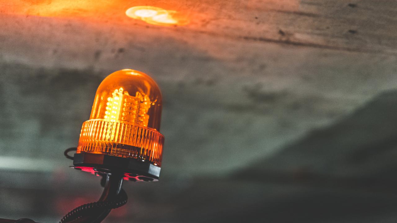 An orange siren alarming
