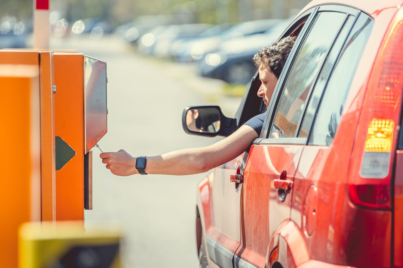 A man entering a car parking lot