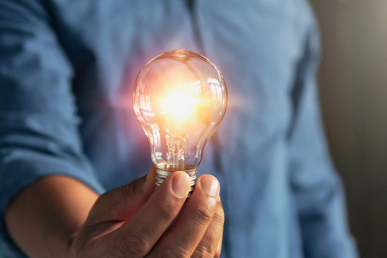 A man holding smart lighting