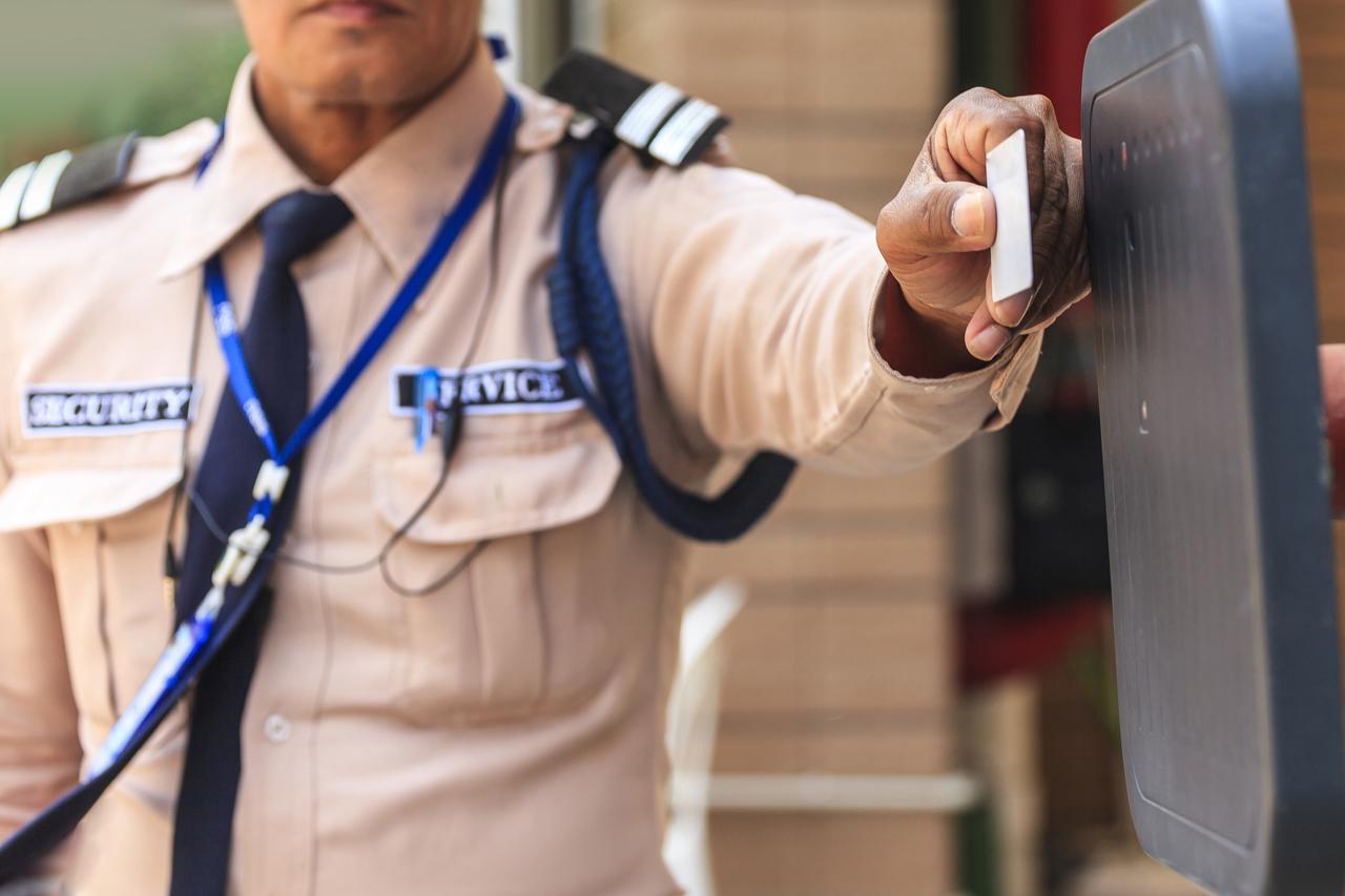 A guard at a car parking entrance