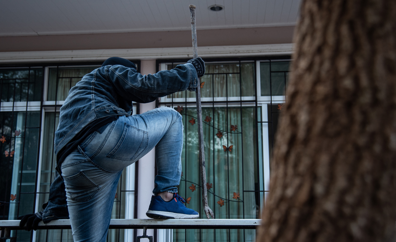 A thief breaking into a house