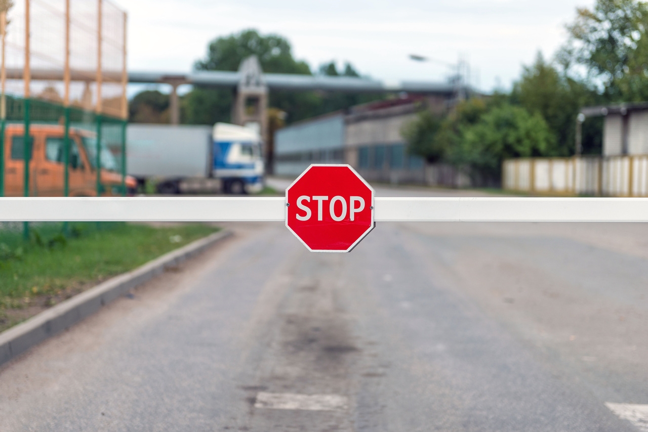A stop sign on a barrier system