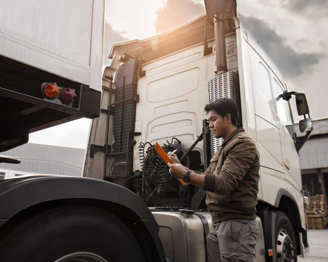 A man taking note of asset truck's condition