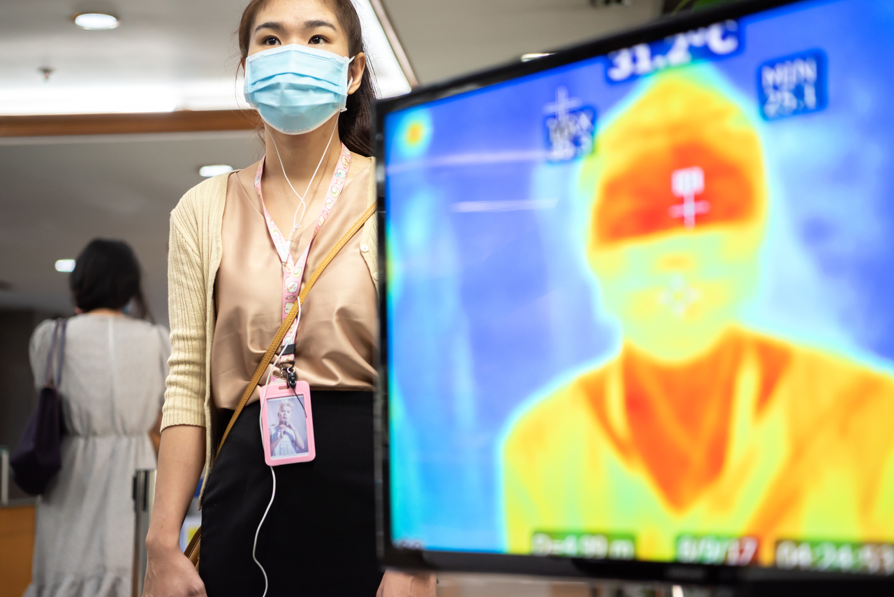 A woman's temperature being read through infrared