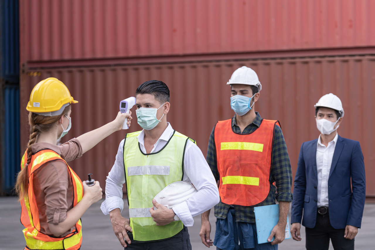 Factory workers getting their temperature checked