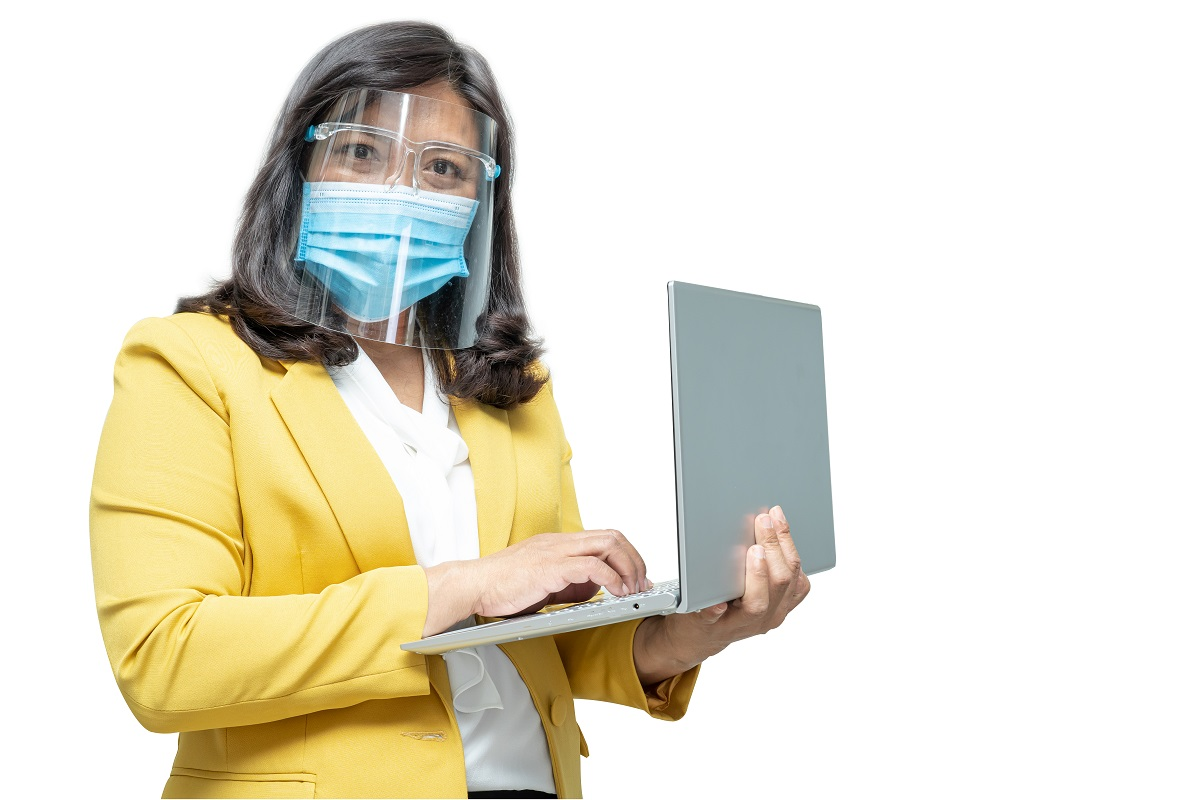 Asian business women use laptop notebook wearing mask and face s