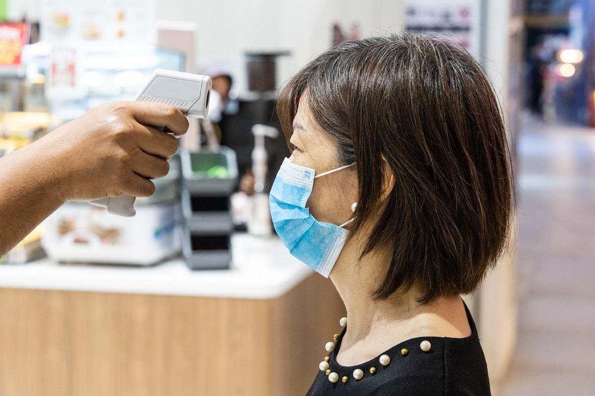 New normal requiring shopper wear mask and scan with thermometer