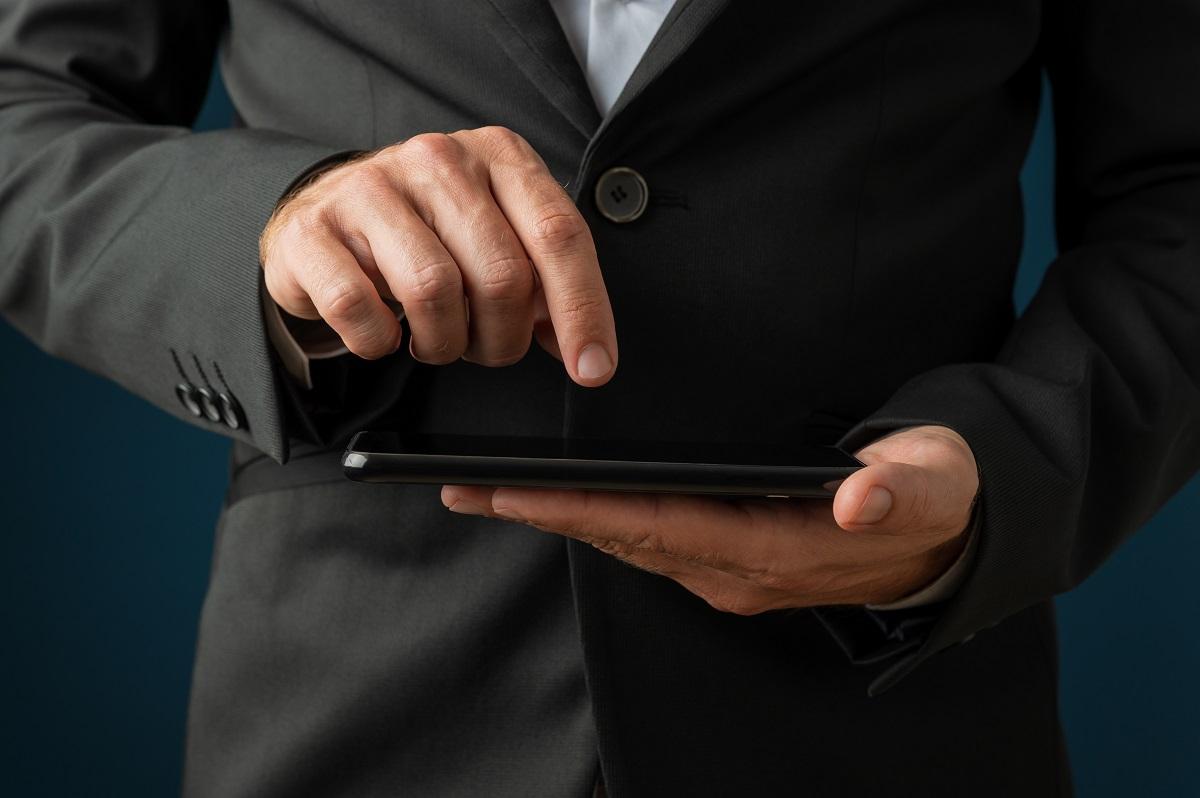 Businessman browsing mobile phone