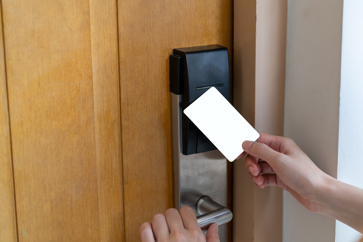 Door access control - woman hand holding white mockup key card t